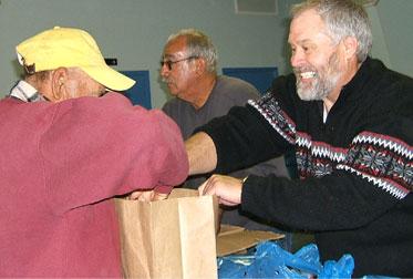 Volunteers helping bag items